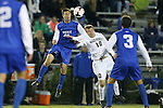 25 October 2013: Duke's Brody Huitema (CAN) (19) and Wake Forest's Teddy Mullin (10) challenge for the ball. The Duke University Blue Devils hosted the Wake Forest University Demon Deacons at Koskinen Stadium in Durham, NC in a 2013 NCAA Division I Men's Soccer match. The game ended in a 2-2 tie after two overtimes.