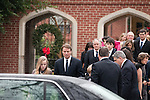 December 11, 2010. Raleigh, NC.. John Edwards, second from left, his daughter Emma Claire, far left,  leave the funeral of Edwards' wife, Elizabeth.. A funeral was held at the Edenton Street United Methodist Church to honor the life of Elizabeth Edwards, the estranged wife of former Democratic presidential candidate John Edwards, who died after an 6 year battle with breast cancer..