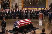 As members of the Bush family look on, the casket containing the remains of former United States President George H.W. Bush rests on the Lincoln Catafalque in the Rotunda of the US Capitol during the ceremony honoring the former President, who will Lie in State in the Rotunda of the US Capitol on Monday, December 3, 2018.<br /> Credit: Ron Sachs / CNP<br /> (RESTRICTION: NO New York or New Jersey Newspapers or newspapers within a 75 mile radius of New York City)