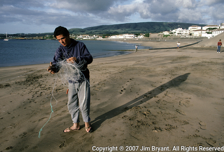 Besides dairy and agriculture, fishing is one of the main occupations on Terceira, Azores. Fisherman untangle nets that will try catch conger, moray eels, mackerel, snapper, bream and swordfish from the rocky shoreline.  (Jim Bryant Photo....