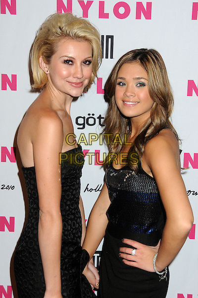 CHELSEA STAUB & NICOLE ANDERSON.Nylon Magazine's Young Hollywood Party held at the Roosevelt Hotel's Tropicana Bar, Hollywood, California, USA..May 12th, 2010.half length dress strapless black blue sequins sequined side hand on hip.CAP/ADM/BP.©Byron Purvis/AdMedia/Capital Pictures.