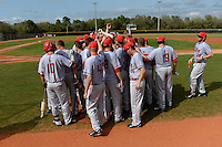 Ball State Cardinals team huddle before a game against the Dartmouth Big Green on March 7, 2015 at North Charlotte Regional Park in Port Charlotte, Florida.  Ball State defeated Dartmouth 7-4.  (Mike Janes/Four Seam Images)