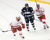 Mike Devin (Cornell - 2), Dalton Speelman (UNH - 10), Riley Nash (Cornell - 14) - The University of New Hampshire Wildcats defeated the Cornell University Big Red 6-2 (EN) on Friday, March 26, 2010, in their NCAA East Regional semi-final at the Times Union Center in Albany, New York.