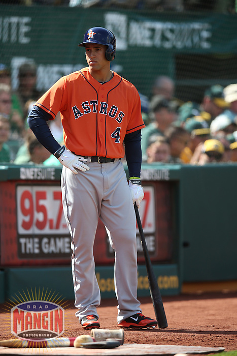 OAKLAND, CA - APRIL 19:  George Springer #4 of the Houston Astros waits in the on deck circle against the Oakland Athletics during the game at O.co Coliseum on Saturday, April 19, 2014 in Oakland, California. Photo by Brad Mangin