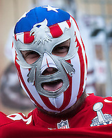 San Francisco 49er's fan sports a face mask while enjoying the pre-match entertainment, National Football League, International Series, Game 8, London, San Francisco 49'ers v Jacksonville Jaguars, London, Wembley Stadium, 27/10/2013 . Picture by Mark Greenwood  -Copyright:  IPS Photo Agency: Cavell Barn, The Common, Swardeston, Norwich, NR14 8DZ - Personal mobile: 07952269496