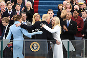 President  Donald J. Trump greets family after taking the Oath of Office at his inauguration on January 20, 2017 in Washington, D.C.  Trump became the 45th President of the United States.        <br /> Credit: Pat Benic / Pool via CNP