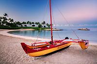 Outrigger boat on beach.  Ko Olina, Oahu, Hawaii
