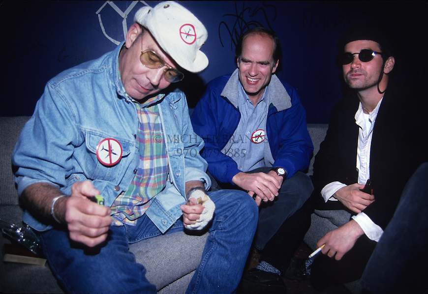 Hunter S. Thompson, Aspen Mayor John Bennett, and local columnist Dan Dunn at a voter registration party in Aspen, CO on 11/7/95. Thompson is looking at a permanent dye ink, which moments later he sprayed throughout the room, and Dunn gets the worst of it. Thompson was later arrested that night for driving while alcohol impaired. © Michael Brands. 970-379-1885.