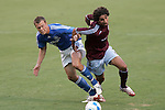 July 22 2007:  Jack Jewsbury (l) of the Wizards and Mehdi Ballouchy (r) of the Rapids battle for a loose ball.  The MLS Kansas City Wizards tied the visiting Colorado Rapids 2-2 at Arrowhead Stadium in Kansas City, Missouri, in a regular season league soccer match.