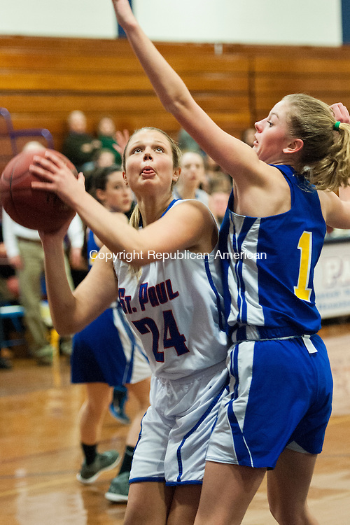 BRISTOL, CT-5 March 2015-030515EC04-   St. Paul's Elizabeth Ferraro eyes the net in front of Housatonic defender Hannah McGuire in the CLass S State Tournament second round game Thursday night. Erin Covey Republican-American