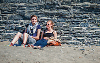 Aberystwyth, Ceredigion, Wales Monday 16th May 2016 UK Weather: People continue to take advantage of the warm weather. Two young women enjoy the warm weather sat on the beach sun bathing.