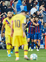 2nd November 2019; Estadi Ciutat de Valencia, Valencia, Spain; La Liga Football, Levante versus FC Barcelona; Borja Mayoral of Levante UD celebrates with his team mates after scoring the second goal for his team 2-1 in minute 62' watched by Lionel Messi and Arturo Vidal of FCB - Editorial Use