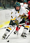 12 December 2009: University of Vermont Catamount forward Wahsontiio Stacey, a Junior from Kahnawake, Quebec, in action against the St. Lawrence University Saints at Gutterson Fieldhouse in Burlington, Vermont. The Catamounts shut out their former ECAC rival Saints 3-0. Mandatory Credit: Ed Wolfstein Photo