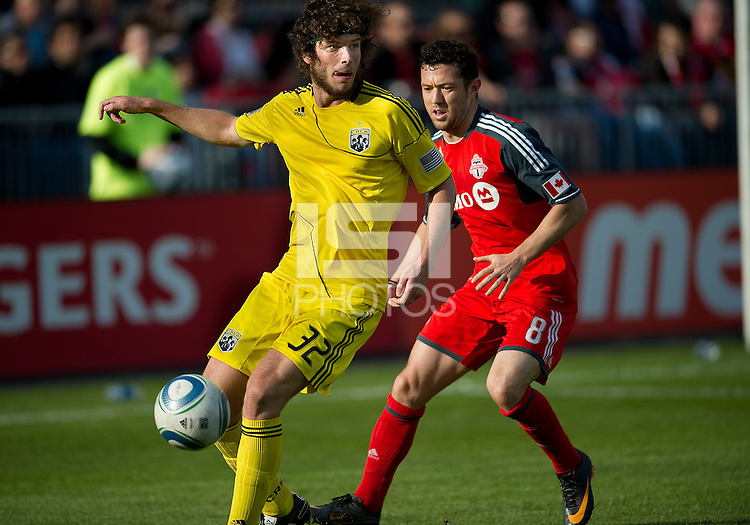23 April 2011: Columbus Crew forward Tom Heinemann #32 and Toronto FC defender Dan Gargan #8 in action during a game between the Columbus Crew and the Toronto FC at BMO Field in Toronto, Ontario Canada..The game ended in a 1-1 draw.