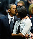 "United States President Barack Obama (L) kisses his wife first lady Michelle Obama after his speech at the event ""Together We Thrive: Tucson and America"" honoring the January 8 shooting victims at McKale Memorial Center on the University of Arizona campus on Wednesday, January 12, 2011 in Tucson, Arizona. The memorial service is in honor of victims of the mass shooting at a Safeway grocery store that killed six and injured at least 13 others, including U.S. Representative Gabrielle Giffords (Democrat of Arizona), who remains in critical condition after being shot in the head. Among those killed were U.S. District Judge John Roll, 63; Giffords' director of community outreach, Gabe Zimmerman, 30; and 9-year-old Christina Taylor Green. .Credit: Kevork Djansezian / Pool via CNP"