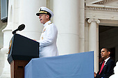 Arlington, VA - May 25, 2009 -- United States President Barack Obama listens to Admiral Michael Mullen, left, Chairman of the Joint Chiefs of Staff, speak during Memorial Day Ceremonies at Arlington National Cemetery in Arlington, VA, U.S.,  Monday, May 25, 2009.  .Credit: Joshua Roberts - Pool via CNP