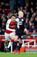 Mesut Ozil of Arsenal in action during the Premier League match between Arsenal and Huddersfield Town at the Emirates Stadium, London, England on 29 November 2017. Photo by Carlton Myrie / PRiME Media Images.