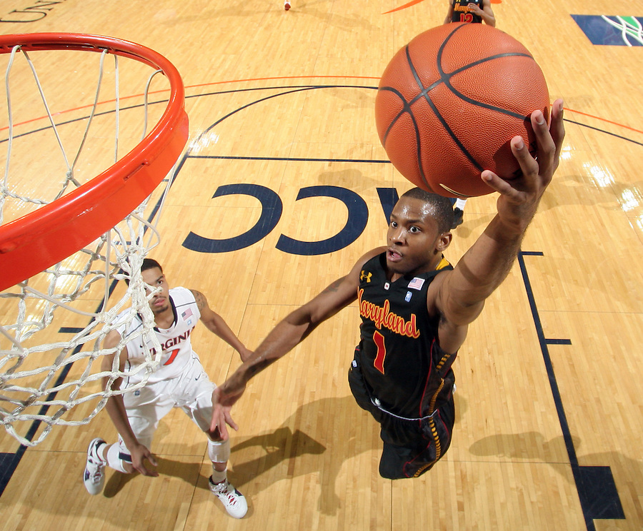 Jan. 27, 2011; Charlottesville, VA, USA; Maryland Terrapins guard Adrian Bowie (1) shoots over Virginia Cavaliers guard Jontel Evans (1) during the game at the John Paul Jones Arena. Maryland won 66-42. Mandatory Credit: Andrew Shurtleff