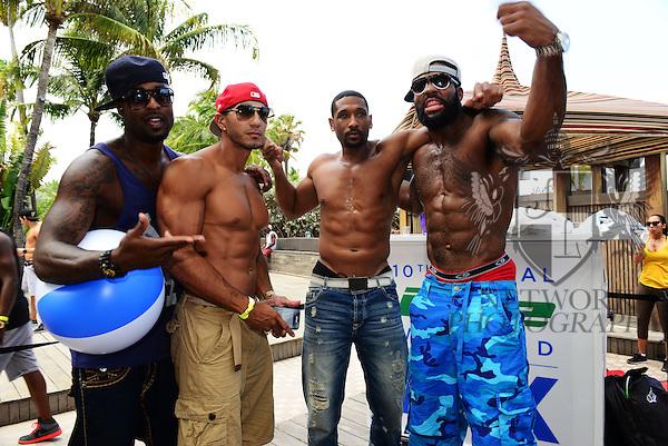 MIAMI BEACH, FL - JUNE 21: Plaxico Burress, Lazaro Montero, Mark Boson and Braylon Edwards attend  DJ Irie Weekend-IWX - BBQ Beach Bash Pool Party at National Hotel on Saturday June 21, 2014 in Miami Beach, Florida. (Photo by Johnny Louis/jlnphotography.com)