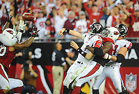 Jan. 3, 2009; Glendale, AZ, USA; Atlanta Falcons quarterback Matt Ryan is tackled for a safety by Arizona Cardinals defensive end (94) Antonio Smith in the fourth quarter during the NFC Wild Card Playoff Game at University of Phoenix Stadium. The Cardinals defeated the Falcons 30-24. Mandatory Credit: Mark J. Rebilas-