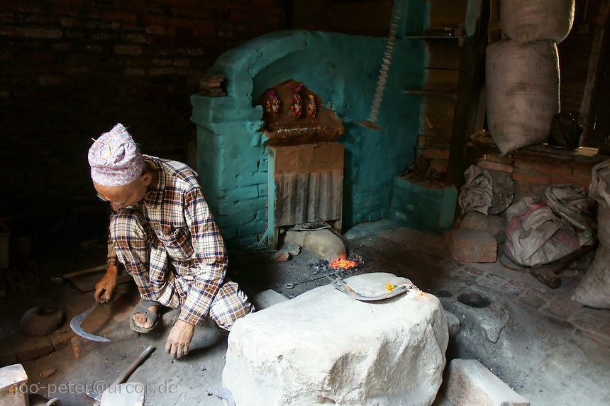 blacksmith in a small home-work place in ground floor of a traditional Newar house in a family neighborhood close to Tachapal square.Bhaktapur, Nepal, October 2011