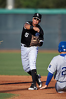 AZL White Sox second baseman Jose Rodriguez (5) throws to first base on a double play attempt during an Arizona League game against the AZL Royals at Camelback Ranch on June 19, 2019 in Glendale, Arizona. AZL White Sox defeated AZL Royals 4-2. (Zachary Lucy/Four Seam Images)