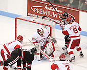 Mike Moran (BU - 11), Josh Manson (NU - 3), Sean Maguire (BU - 31), Ryan Ruikka (BU - 2), Matt Grzelcyk (BU - 5), Steve Morra (NU - 12) - The Boston University Terriers defeated the visiting Northeastern University Huskies 5-0 on senior night Saturday, March 9, 2013, at Agganis Arena in Boston, Massachusetts.