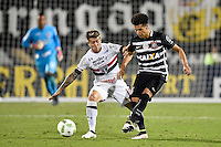 Orlando, FL - Saturday Jan. 21, 2017: Corinthians midfielder Marquinhos Gabriel (31) plays the ball away from São Paulo midfielder Buffarini (18) during the second half of the Florida Cup Championship match between São Paulo and Corinthians at Bright House Networks Stadium. The game ended 0-0 in regulation with São Paulo defeating Corinthians 4-3 on penalty kicks