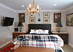 """The guest bedroom. """"At Home"""" with Margaret Lowery in her Lake Christine Drive home in Belleville, IL on July 24, 2019. <br /> Photo by Tim Vizer"""