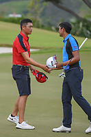 Zheng Kai BAI (CHN) shakes hands with Sadom KAEWKANJANA (THA) following Rd 3 of the Asia-Pacific Amateur Championship, Sentosa Golf Club, Singapore. 10/6/2018.<br /> Picture: Golffile | Ken Murray<br /> <br /> <br /> All photo usage must carry mandatory copyright credit (© Golffile | Ken Murray)