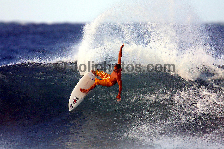 Six times World Surfing Champion, Kelly Slater (USA), from Florida USA takes advantage of a two meter swell at Kirra  to get  some practise for the the Quiksilver Pro.<br /> Monday March 5 2001.<br /> Photo: Joliphots.com