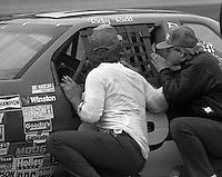Bill Elliott talks with crewmen Daytona 500 at Daytona International Speedway in Daytona Beach, FL on February 14, 1988. (Photo by Brian Cleary/www.bcpix.com)