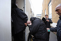 Pictured: Robert Riley (C) is led handcuffed by a custody officer to a waiting prison van after being sentenced by Swansea Magistrates. Thursday 08 May 2014<br />