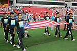 13 August 2008: Olympic volunteers carry the United States flag onto the field, pregame.  The men's Olympic team of Nigeria defeated the men's Olympic soccer team of the United States 2-1 at Beijing Workers' Stadium in Beijing, China in a Group B round-robin match in the Men's Olympic Football competition.