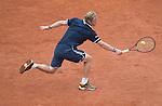 Dimitry Tursunov (RUS) loses the first set to Roger Federer (SUI)  at  Roland Garros being played at Stade Roland Garros in Paris, France on May 30, 2014