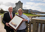 Paddy Patrick from New Zealand being presented with an Irish Heritage certificate by Jimmy Deenihan TD Minister for Arts, Heritage  and Gaeltacht Affairs, at Ross Castle Killarney.  Picture: MacMonagle, Killarney.