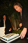 "CHRIS CARTER. The disc jockey cuts the cake at the George Harrison Public Birthday Celebration by the Alliance for Survival, hosted by Jerry Rubin and ""Breakfast with the Beatles"" radio host Chris Carter at George Harrison's star on the Walk of Fame. Hollywood, CA, USA. February 25, 2010."