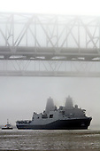 New Orleans, LA - October 13, 2009 -- In this photo provided by the United States Navy, the amphibious transport dock ship Pre-Commissioning Unit (PCU) New York (LPD 21) maneuvers under the New Orleans Crescent City Connection bridge on the Mississippi River Tuesday, October 13, 2009, after departing Northrop Grumman Ship Systems in Avondale, Louisiana. New York has 7.5 tons of steel from the World Trade Center in her bow, and is scheduled to be commissioned November 7 in New York..Mandatory Credit: John P. Curtis / US Navy via CNP