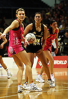 World captain Natasha Chokljat and NZ wing attack liana Barrett-Chase respond to an umpire's call during the International  Netball Series match between the NZ Silver Ferns and World 7 at TSB Bank Arena, Wellington, New Zealand on Monday, 24 August 2009. Photo: Dave Lintott / lintottphoto.co.nz