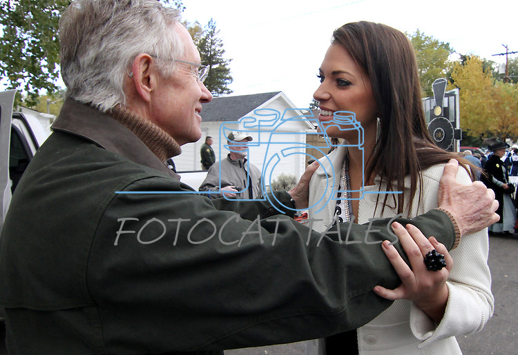 Senate Majority Leader Harry Reid talks with Ms. Nevada USA Julianna Erdesz before the Nevada Day parade on Saturday, Oct. 30, 2010, in Carson City, Nev. .Photo by Cathleen Allisonz