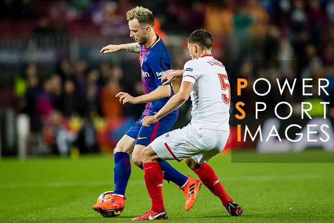 Ivan Rakitic of FC Barcelona (L) fights for the ball with Clement Nicolas Laurent Lenglet of Sevilla FC (R) during the La Liga 2017-18 match between FC Barcelona and Sevilla FC at Camp Nou on November 04 2017 in Barcelona, Spain. Photo by Vicens Gimenez / Power Sport Images