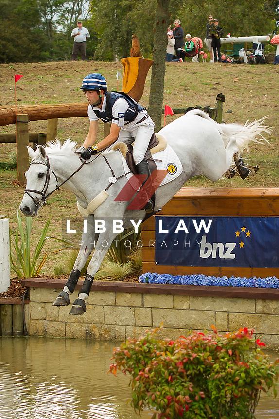 NZL-Clarke Johnstone (BALMORAL SENSATION) INTERIM-1ST: CIC3* CROSS COUNTRY: 2014 NZL-BNZ Kihikihi International Horse Trial (Saturday 12 April) CREDIT: Libby Law COPYRIGHT: LIBBY LAW PHOTOGRAPHY - NZL