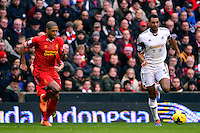 Sunday, 23 February 2014<br /> Pictured: Swansea City's David Ngog is chased down by Liverpool's Glen Johnson<br /> Re: Barclay's Premier League, Liverpool FC v Swansea City FC v at Anfield Stadium, Liverpool Merseyside, UK.