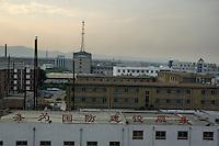 Rooftops of city buildings at sunset, Datong, Shanxi, China.