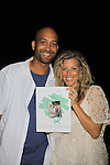 """General Hospital Laura Wright """"Carly"""" poses with Tyrone who went to the same high school, Surrattsville in Maryland at a Wine Tasting for Standing Sun Wines on August 11, 2012 at MaGooby's Joke House in Timonium, Maryland. The fans got a chance to takes all the various wines, a Q&A, photos, autographs. L(Photo by Sue Coflin/Max Photos)"""
