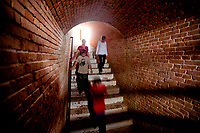 Fort Barrancas visitors descend the tunnel that connects the pre-Civil War era fort to the lower Water Battery defenses.<br /> <br /> <br /> COLIN HACKLEY PHOTO