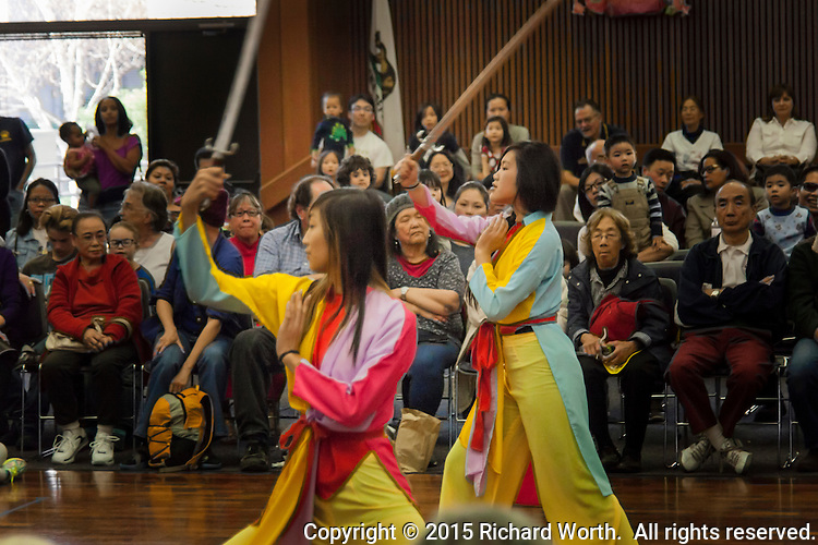 A pair of dancers from the China Dance School of San Francisco perform during a Lunar New Year Celebration at a neighborhood library.