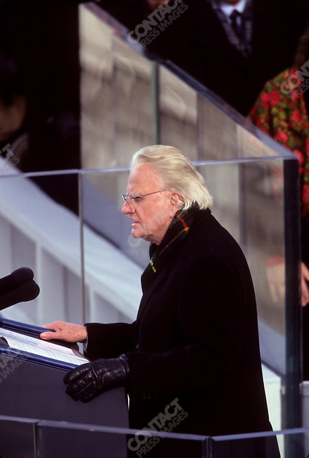 Reverend Billy Graham, American evangelist, gives the invocation at U.S. President William Jefferson Clinton's second inauguration ceremony. Washington, D.C., February 1997