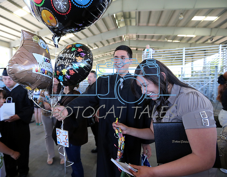 Graduate Arnulfo Pacheco, Jr. celebrates with his sister Jesseca following the 2013 Western Nevada College Commencement at the Pony Express Pavilion, in Carson City, Nev., on Monday, May 20, 2013. .Photo by Cathleen Allison