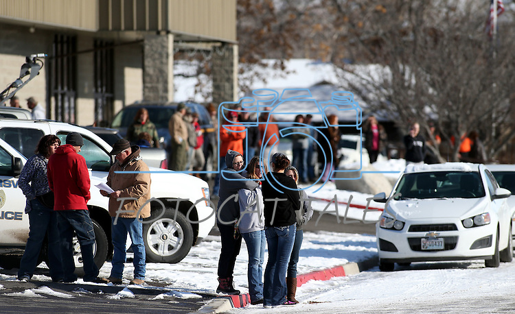 A crowd gathers outside the command post in Lovelock, Nev., on Tuesday, Dec. 10, 2013, awaiting the return of a group of six people who survived two days in the frigid mountains east of Reno. The two adults and four children are being treated at the local hospital. (AP Photo/Cathleen Allison)